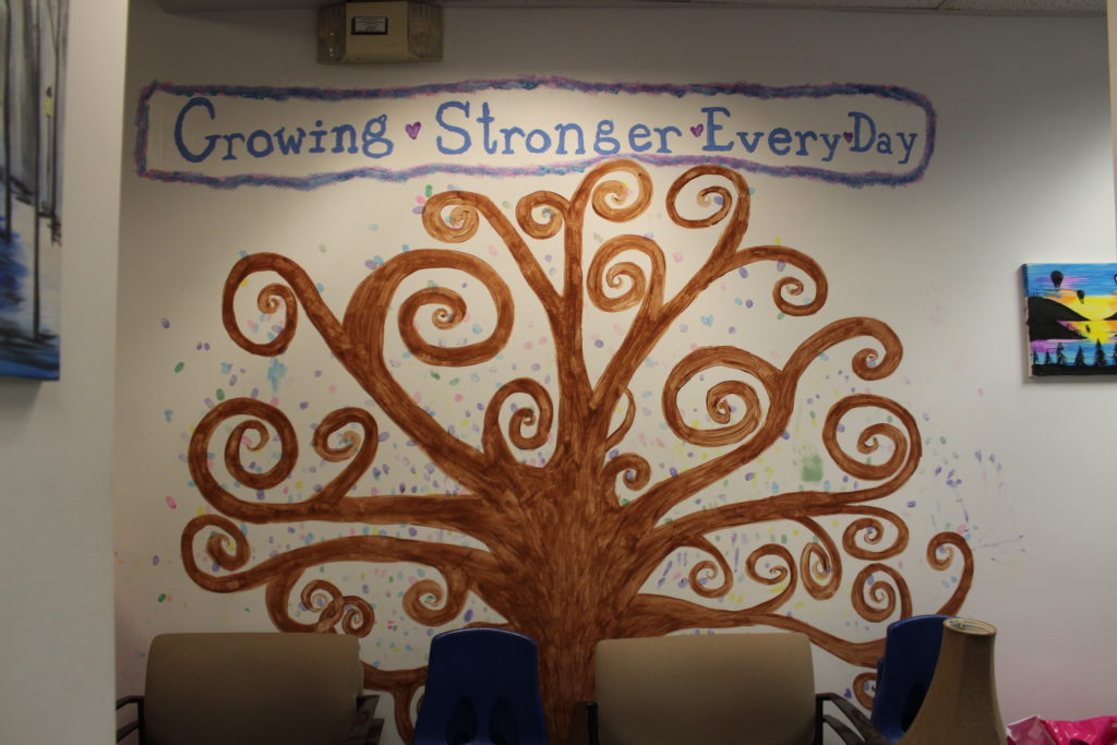 photo of tree wall painting at safe harbor